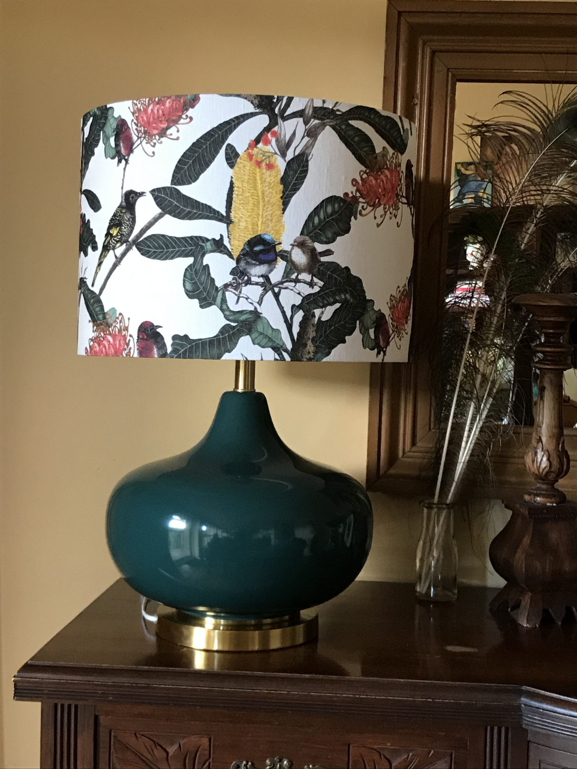 interior image showing a beautiful lampshade customer made for a client by Green Room interiors with Banksia Medley linen matching perfectly with a jade colour table base..